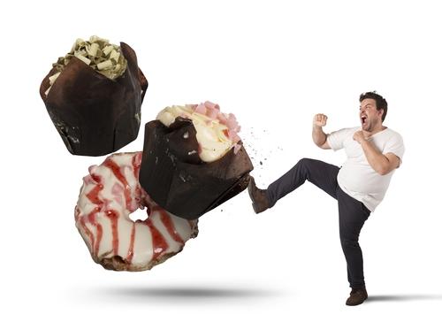 man kicking away sweets