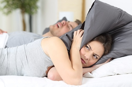 woman angry at man snoring