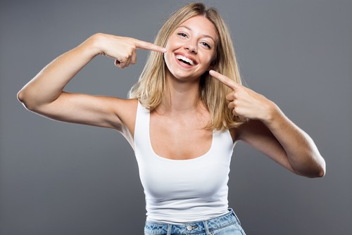 woman pointing at smile