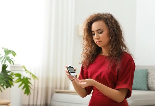 woman tests blood sugar